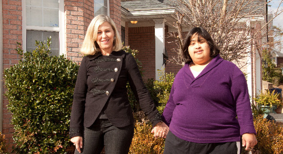 Pat and Mia Nobbie in front of Mia's house